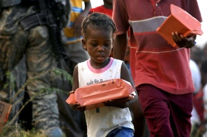 A child receives food rations after the Haiti Earthquake