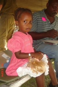 A Young Girl Sits in the Pediatric Department Tent of the IDF Field Hospital in Haiti. - http://www.flickr.com/photos/israel-mfa/4299966920/